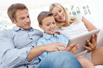 Buy stock photo A family of three using a digital tablet together