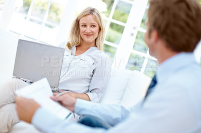 Buy stock photo A mature couple budgeting together in their lounge