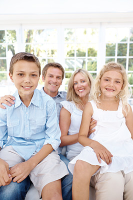 Buy stock photo Portrait of a smiling family with their children on their laps