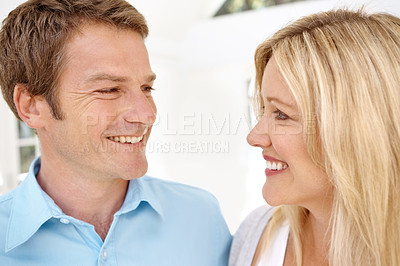 Buy stock photo Closeup shot of an happy couple looking at each other