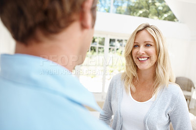 Buy stock photo Smiling mature woman looking pleased to see her husband