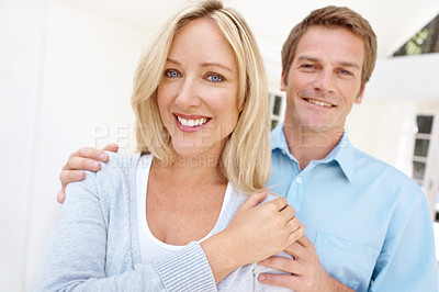Buy stock photo Affectionate mature couple spending time together indoors
