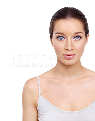Buy stock photo Gorgeous young woman with perfect skin looking at you against a white background