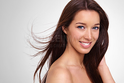 Buy stock photo Cropped view of a pretty young woman with long, healthy hair against a white background