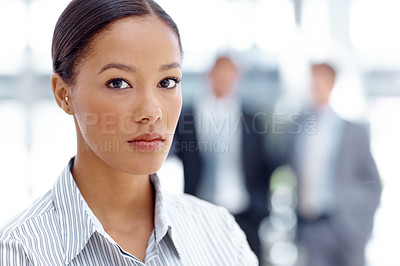 Buy stock photo A dedicated young businesswoman looking stern