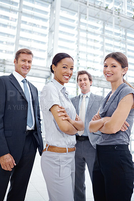 Buy stock photo Portrait of a successful business team standing together and smiling