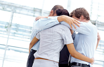 Buy stock photo A group of businesspeople huddling together