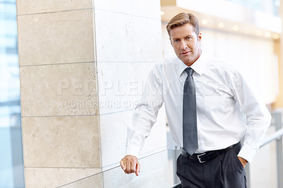 Buy stock photo A handsome businessman looking at the camera