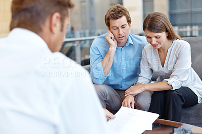 Buy stock photo A couple listening to what the financial advisor has to say