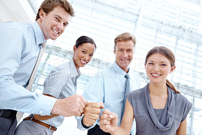 Buy stock photo Group of positive businesspeople putting their hands together in solidarity