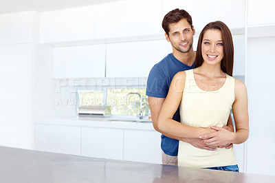 Buy stock photo Portrait of a happy couple in their new kitchen with copyspace