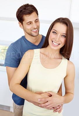 Buy stock photo Portrait of a happy couple in their new kitchen