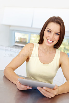 Buy stock photo A pretty woman looking at her touchscreen - portrait
