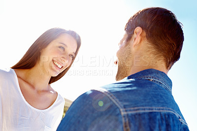 Buy stock photo A couple looking lovingly at each other and standing outside