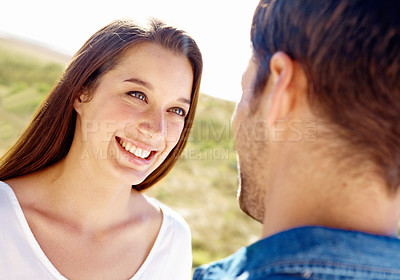 Buy stock photo A happy excited girlfriend looking lovingly at her boyfriend in the outdoors
