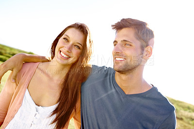 Buy stock photo A relaxed smiling couple walking in a field