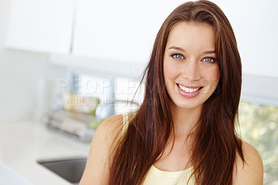 Buy stock photo Portrait of an attractive young woman standing in her kitchen