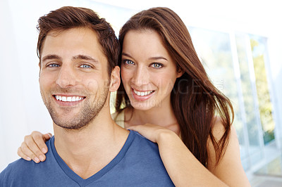 Buy stock photo Close up portrait of a young woman embracing her husband from behind