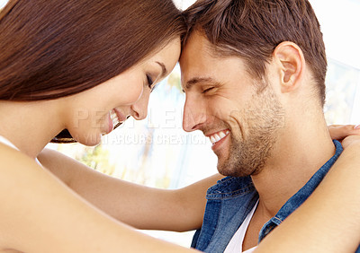 Buy stock photo Cropped close up shot of a laughing young couple with their foreheads touching and their eyes closed