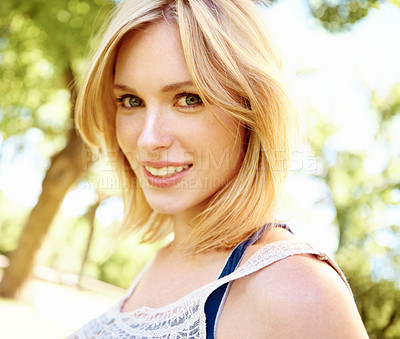 Buy stock photo Portrait of a smiling blonde woman in the park with copyspace