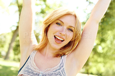 Buy stock photo A portrait of a beautiful young woman with arms raised in the air positively