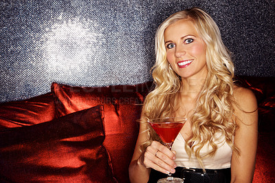 Buy stock photo A beautiful woman in a nightclub holding a cocktail