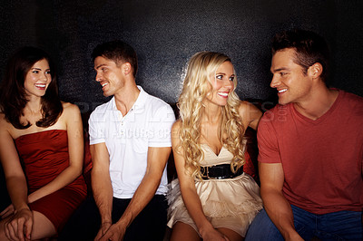 Buy stock photo Two couples talking in a nightclub