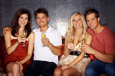 Buy stock photo Two couples drinking champagne in a night club
