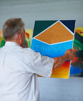 Buy stock photo Cropped shot of a senior man looking at a painting in his bedroom