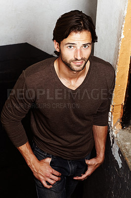 Buy stock photo Portrait of a handsome young man with his hands in his pockets
