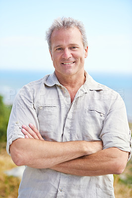 Buy stock photo Portrait of a mature man smiling happily at the camera