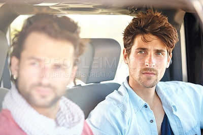 Buy stock photo Two friends driving together while on a road trip