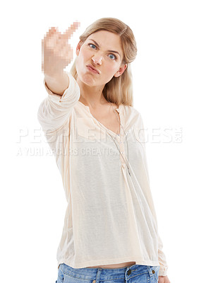 Buy stock photo Studio shot of a beautiful young woman showing the middle finger against a white background