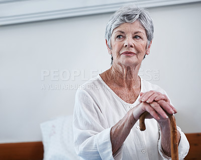 Buy stock photo Shot of a senior woman sitting in a hospital ward