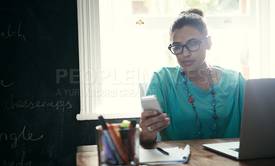 Buy stock photo Cropped shot of an attractive young woman working from home