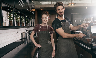 Buy stock photo Portrait of two baristas working behind the counter in a cafe