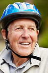 Closeup of a happy senior man wearing bicycle helmet