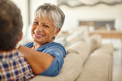 Buy stock photo Shot of a happy senior couple enjoying quality time together at home