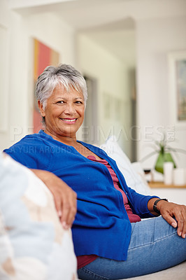 Buy stock photo Portrait of an attractive senior woman enjoying a relaxing day at home