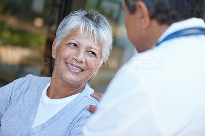Buy stock photo Cropped shot of a senior woman talking to her doctor