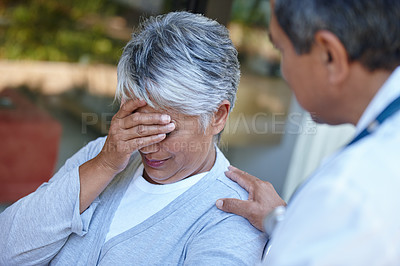 Buy stock photo Cropped shot of a senior woman with her doctor