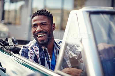Buy stock photo A handsome young man driving in his convertible