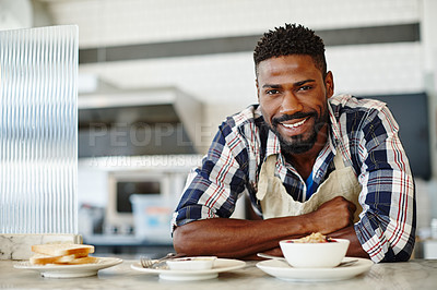 Buy stock photo Cropped portrait of a handsome young man working in a coffee shop