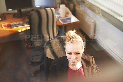 Buy stock photo High angle shot of an attractive businesswoman using her work computer