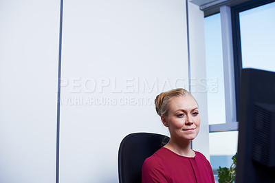 Buy stock photo Cropped shot of an attractive businesswoman using her work computer