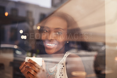 Buy stock photo Shot of an attractive young woman sitting drinking coffee at a cafe