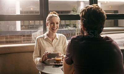 Buy stock photo Cropped shot of a young couple having coffee in a cafe