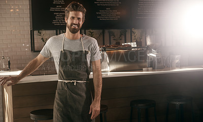 Buy stock photo Cropped shot of a handsome young man working in a cafe