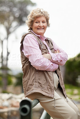 Buy stock photo Portrait of a happy mature woman relaxing with hands folded