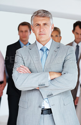 Buy stock photo Portrait of confident mature businessman standing in front of his team